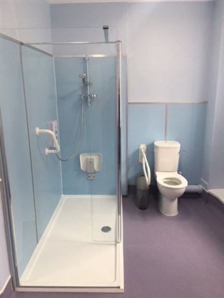 Disabled shower room created from communal toilets for - Disabled shower room ...