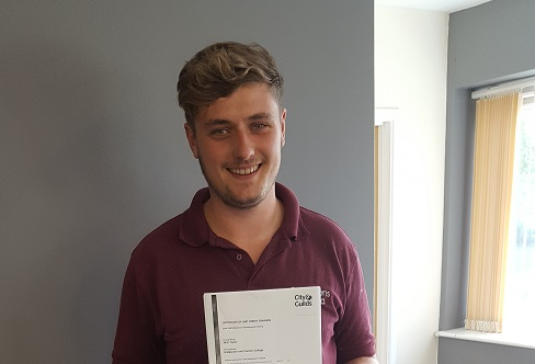 Apprentice Niall Taylor passes his Level 2 NVQ in Plumbing and Heating